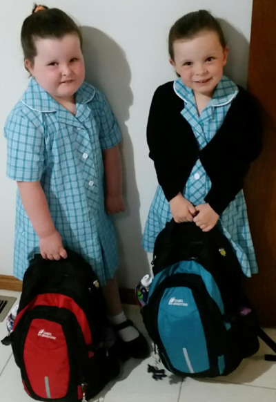 Grace & Kaye dressed and ready for their first day of school
